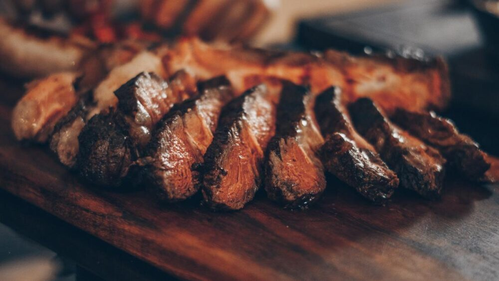 Sliced Grilled Steak On Wood Serving Tray